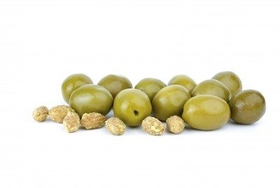 Green olives and some pits isolated on the white background