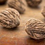 black walnuts on a grunge wood surface with a selective focus