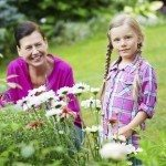 Girl and granny gardening together