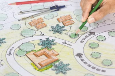 Landscape Architect Designs Blueprints For Resort.